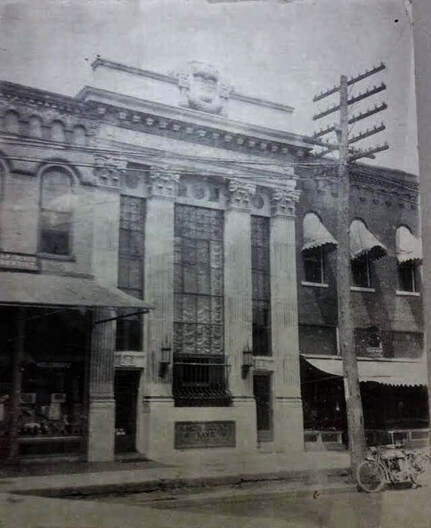 Historic photo of the building around 1900